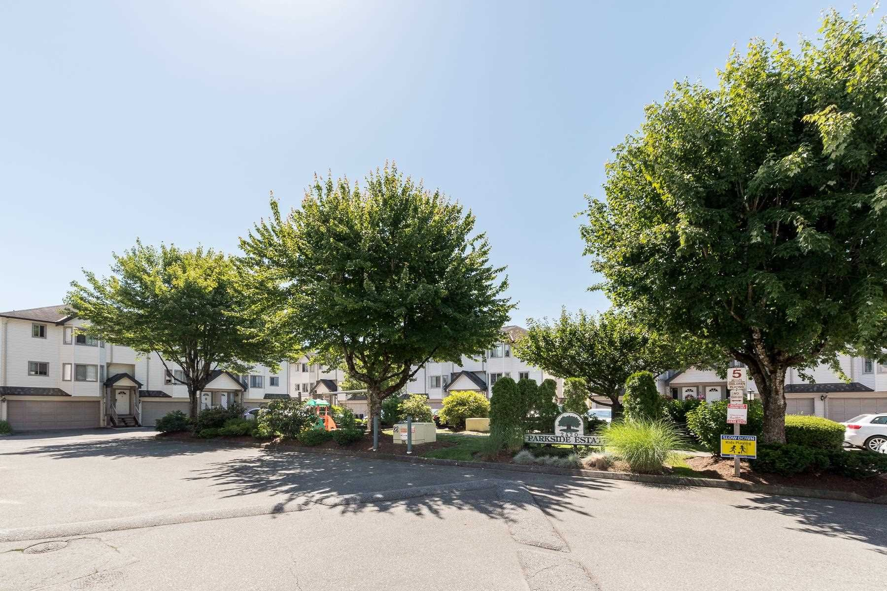 """Main Photo: 12 2420 PITT RIVER Road in Port Coquitlam: Mary Hill Townhouse for sale in """"PARKSIDE ESTRATA"""" : MLS®# R2596291"""