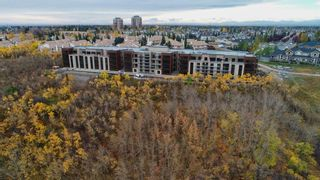 Photo 2: 303 15 Cougar Ridge Landing SW in Calgary: Patterson Apartment for sale : MLS®# A1095946
