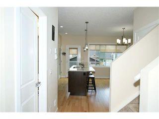 Photo 11: 118 FIRESIDE Bend: Cochrane House for sale : MLS®# C4066576