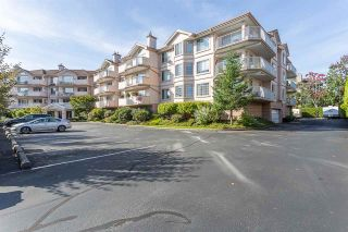 """Photo 1: 102 5375 205 Street in Langley: Langley City Condo for sale in """"GLENMONT PARK"""" : MLS®# R2335377"""