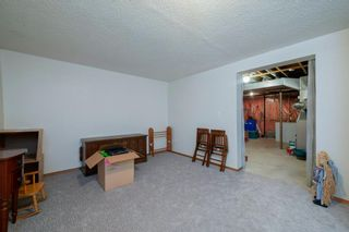 Photo 38: 332 Queenston Heights SE in Calgary: Queensland Row/Townhouse for sale : MLS®# A1114442