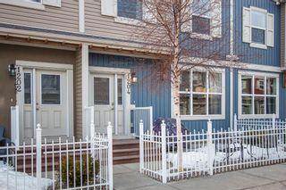 Photo 3: 1204 10 AUBURN BAY Avenue SE in Calgary: Auburn Bay Row/Townhouse for sale : MLS®# A1065411