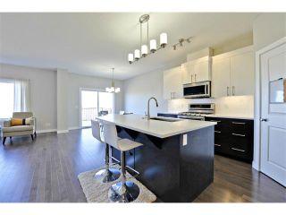 Photo 9: 140 FIRESIDE Place: Cochrane House for sale : MLS®# C4004650