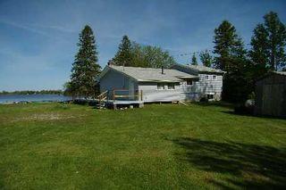 Photo 1: 43 Cedar Bay Road in Kawartha Lakes: Rural Carden House (Bungalow) for sale : MLS®# X2544328
