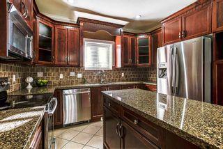 "Photo 6: 24318 102 Avenue in Maple Ridge: Albion House for sale in ""Castle Brook"" : MLS®# R2126861"