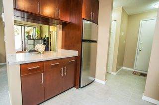 """Photo 3: 303 9155 SATURNA Drive in Burnaby: Simon Fraser Hills Condo for sale in """"Mountainwood"""" (Burnaby North)  : MLS®# R2042603"""