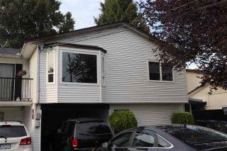 Photo 1: 12649 93 Avenue in Surrey: Queen Mary Park Surrey 1/2 Duplex for sale : MLS®# R2399379