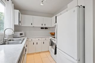 Photo 7: 103 120 Silvercreek Close NW in Calgary: Silver Springs Row/Townhouse for sale : MLS®# A1129249