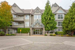 "Photo 1: 110 6557 121 Street in Surrey: West Newton Condo for sale in ""Lakewood Terrace"" : MLS®# R2504332"