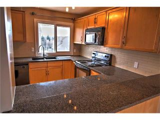 Photo 2: 248 54 GLAMIS Green SW in Calgary: Glamorgan House for sale : MLS®# C4109785