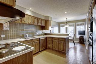 Photo 12: 607 Stratton Terrace SW in Calgary: Strathcona Park Row/Townhouse for sale : MLS®# A1065439