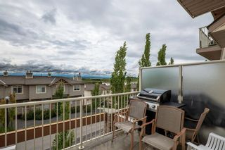 Photo 12: 9 140 Rockyledge View NW in Calgary: Rocky Ridge Row/Townhouse for sale : MLS®# A1118889