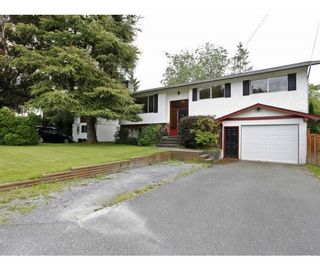 Photo 1: 32716 SWAN AV in Mission: Mission BC House for sale : MLS®# F1415463