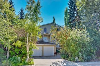 Main Photo: 619 Crescent Boulevard SW in Calgary: Elboya Detached for sale : MLS®# A1104403