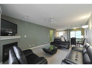 "Photo 7: 306 12083 92A Avenue in Surrey: Queen Mary Park Surrey Condo for sale in ""Tamaron"" : MLS®# F1430148"
