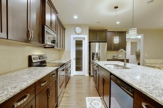 Photo 10: 1100 Brightoncrest Green SE in Calgary: New Brighton Detached for sale : MLS®# A1060195