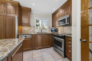 Photo 5: 28 Glacier Place SW in Calgary: Glamorgan Detached for sale : MLS®# A1091436