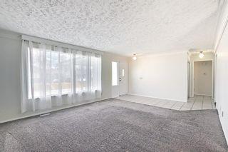 Photo 3: 239 Queen Tamara Way SE in Calgary: Queensland Detached for sale : MLS®# A1100058