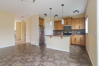 Photo 16: 296 Sunset Point: Cochrane Row/Townhouse for sale : MLS®# A1134676