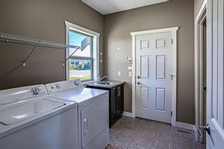 Photo 11: 121 Kinniburgh Boulevard: Chestermere Detached for sale : MLS®# A1147632