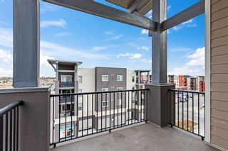 Photo 22: 7411 403 Mackenzie Way SW: Airdrie Apartment for sale : MLS®# A1152134