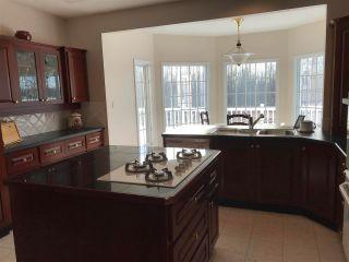 """Photo 2: 13103 TAMARACK Avenue in Charlie Lake: Fort St. John - Rural W 100th House for sale in """"ASPEN RIDGE"""" (Fort St. John (Zone 60))  : MLS®# R2576684"""