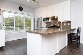 """Photo 7: 40 6971 122 Street in Surrey: West Newton Townhouse for sale in """"Aura"""" : MLS®# R2120843"""