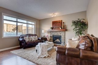 Photo 11: 209 HERITAGE Boulevard: Cochrane House for sale : MLS®# C4172934