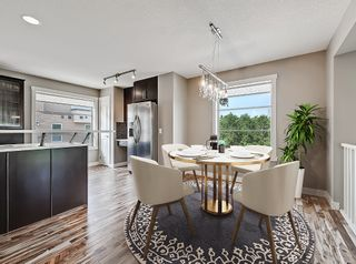 Photo 4: 27 Aspen Hills Common SW in Calgary: Aspen Woods Row/Townhouse for sale : MLS®# A1134206