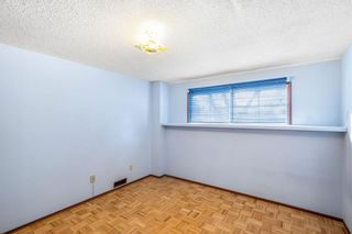 Photo 27: 128 Dovertree Place SE in Calgary: Dover Semi Detached for sale : MLS®# A1075565