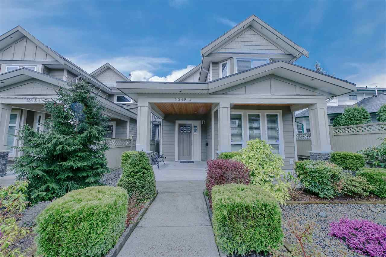 Main Photo: 1048 A DANSEY Avenue in Coquitlam: Central Coquitlam 1/2 Duplex for sale : MLS®# R2562405