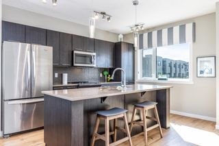 Photo 1: 1001 218 Sherwood Square NW in Calgary: Sherwood Row/Townhouse for sale : MLS®# A1147454