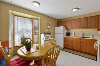 Photo 3: 15 1845 Lysander Crescent SE in Calgary: Ogden Row/Townhouse for sale : MLS®# A1093994