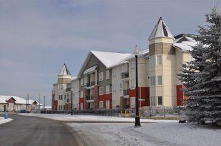 Photo 2: 337 26 VAL GARDENA View SW in Calgary: Springbank Hill Condo for sale : MLS®# C4139535
