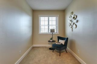 Photo 11: 17 11 Scarpe Drive SW in Calgary: Garrison Woods Row/Townhouse for sale : MLS®# A1103969
