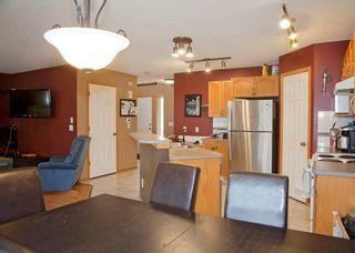 Photo 10: 48 CIMARRON MEADOWS Road: Okotoks House for sale : MLS®# C4174831