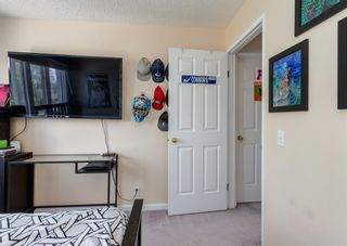 Photo 27: 19 Coachway Green SW in Calgary: Coach Hill Row/Townhouse for sale : MLS®# A1144999