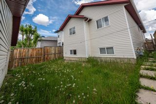 Photo 5: 57 MARTINVALLEY Place in Calgary: Martindale Detached for sale : MLS®# A1117247