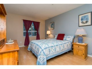 "Photo 8: 106 13860 70 Avenue in Surrey: East Newton Condo for sale in ""Chelsea Gardens"" : MLS®# R2243346"