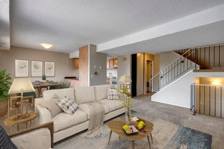 Main Photo: 809 2200 Woodview Drive SW in Calgary: Woodlands Row/Townhouse for sale : MLS®# A1128353