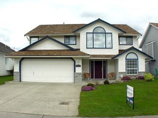 """Photo 1: 35453 LETHBRIDGE Drive in Abbotsford: Abbotsford East House for sale in """"Sandy Hill"""" : MLS®# F1110467"""