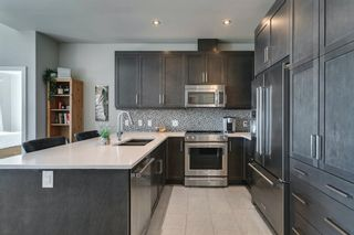 Photo 15: 408 145 Burma Star Road SW in Calgary: Currie Barracks Apartment for sale : MLS®# A1120327
