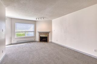 Photo 2: 308 9948 151 Street in Surrey: Guildford Condo for sale (North Surrey)  : MLS®# R2402381