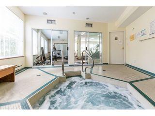 """Photo 18: 308 15150 108 Avenue in Surrey: Guildford Condo for sale in """"Riverpointe"""" (North Surrey)  : MLS®# R2398810"""