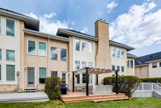 Photo 3: 91 Candle Terrace SW in Calgary: Canyon Meadows Row/Townhouse for sale : MLS®# A1107122