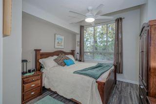 "Photo 13: 403 16068 83 Avenue in Surrey: Fleetwood Tynehead Condo for sale in ""Fleetwood Gardens"" : MLS®# R2521959"
