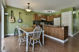Photo 9: 93 Rocky Vista Circle NW in Calgary: Rocky Ridge Row/Townhouse for sale : MLS®# A1071802