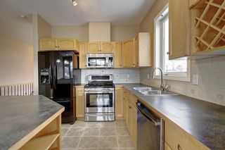 Photo 4: 91 Evercreek Bluffs Place SW in Calgary: Evergreen Semi Detached for sale : MLS®# A1075009