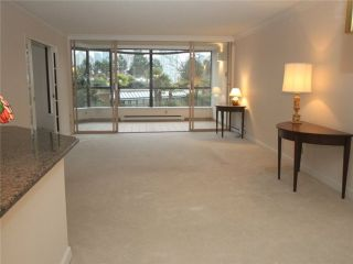 """Photo 3: 102 1470 PENNYFARTHING Drive in Vancouver: False Creek Condo for sale in """"HARBOUR COVE"""" (Vancouver West)  : MLS®# V1038676"""