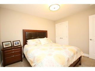 Photo 34: 156 GLENEAGLES Close: Cochrane House for sale : MLS®# C4018066